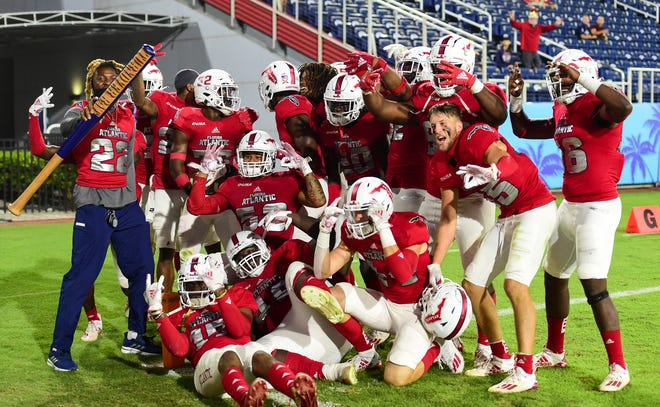 The FAU defense, celebrating an interception during the fourth quarter of FAU's win over UMass last month, will be going to a bowl game later this month along with the rest of the team.