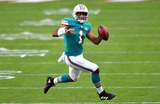 Miami Dolphins quarterback Tua Tagovailoa (1) looks for a receiver down the field in the first quarter against the Kansas City Chiefs at Hard Rock Stadium in Miami Gardens, December 13, 2020.