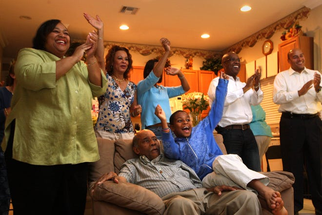 Marcus Garvey Jr., the son of late civil rights activist Marcus Garvey (seated in chair) watches election returns with family and friends in Wellington on Nov. 4, 2008, as Barack Obama became the first Black president of the United States. Garvey Jr. died Dec. 8 in Wellington after a long battle with Alzheimer's disease.