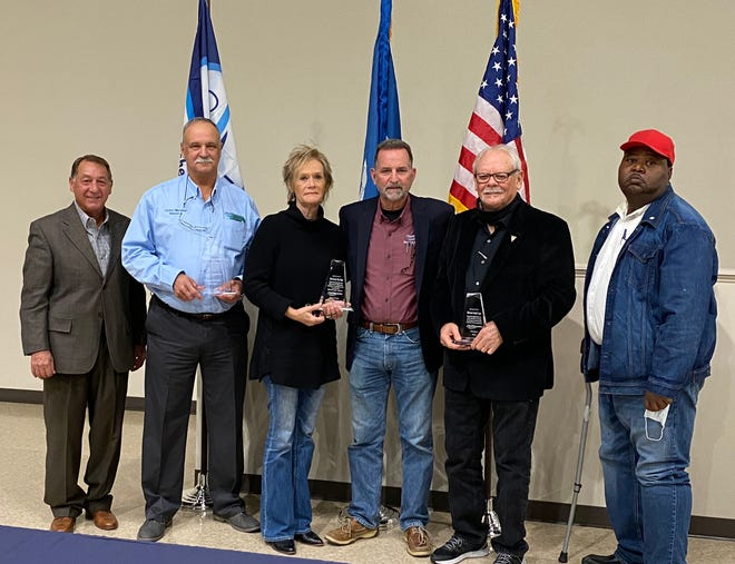 Shown with their awards are from left, Selectman Lin Rivet, Selectman Timmy Martinez, Selectwoman Chris Stassi, Mayor Ed Reeves, Jr., Selectman Russell Gerace and Selectman Jimmie Randle. Not shown is Selectman Oscar Mellion.