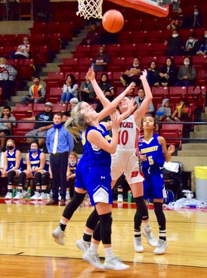 Ballinger's Jewel Klaras takes a hard foul against Veribest on December 8. The Lady Cats held the Falcons to 12 points in the first half, but fell short, 32-28 when the final buzzer sounded.