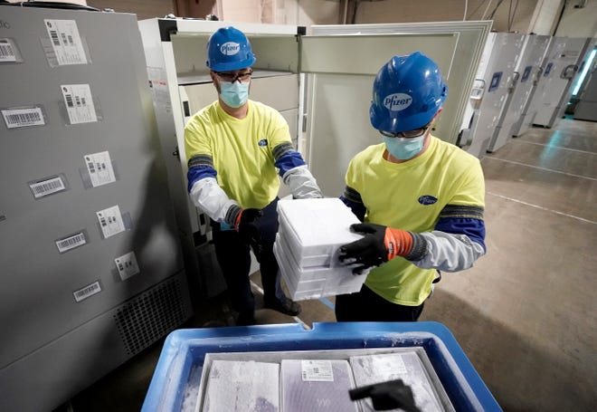 Boxes containing the Pfizer-BioNTech COVID-19 vaccine are prepared to be shipped at the Pfizer Global Supply Kalamazoo manufacturing plant in Portage, Mich., Sunday, Dec. 13, 2020.