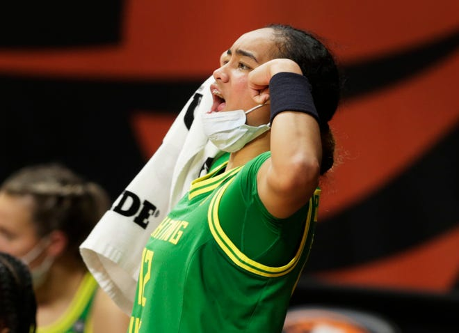 Oregon's Te-Hina Paopao flexes her arms in celebration from the sideline during the second half of the Ducks' 79-59 win at Oregon State on Sunday.