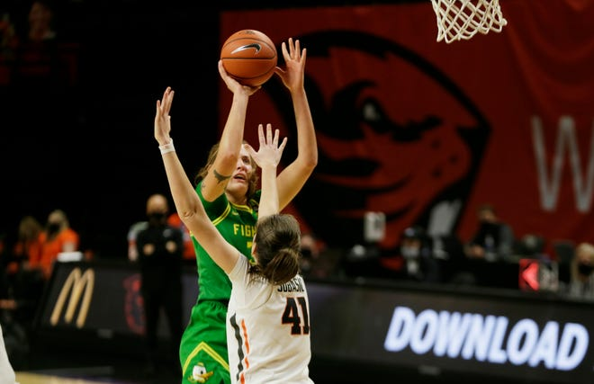 Oregon's Sedona Prince shots over Oregon State's Jovana Subasic during the second half of their game in Corvallis last month.