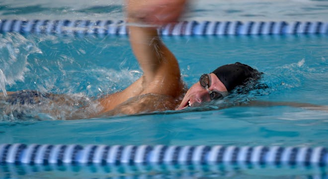 Chris Allshouse, a 1988 Perry High graduate and former competitive swimmer, trains at the North Canton YMCA. Allshouse recently became the first person to make the 23.6-mile swim along the eastern coast of the Caribbean island of St. Lucia.