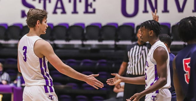Tarleton's Konstantin Dotsenko and Shamir Bogues celebrate a call during a recent game. Texans head coach Billy Gillispie announced on Monday that the men's basketball program is pausing all team activities as a result of COVID-19 protocols.