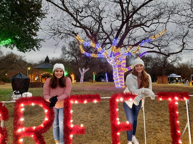 Stephenville High School theater students were among volunteers who helped set up the Light Up the Night event being held at Stephenville City Park.