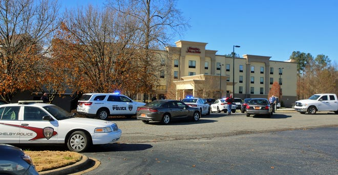 Police surround the Hampton Inn in Shelby after a shooting on Monday. The incident apparently began near the Cleveland Mall.