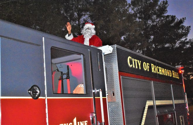 "Santa Claus shown last week has been visiting city neighborhoods atop his Richmond Hill Fire Department ""sled."""