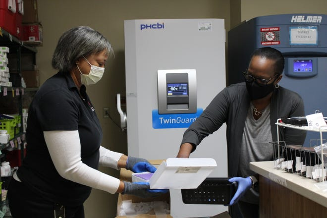 Staffers at the Chatham County Health Department unload doses of the COVID-19 vaccine.