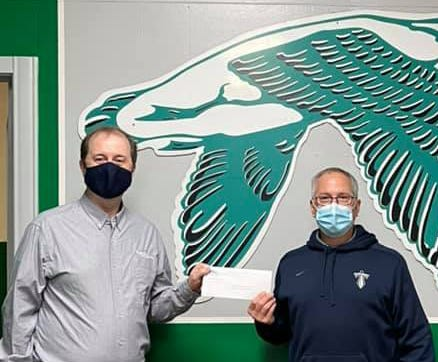 Jon Looney, left, presents a check for $5,250 to Wethersfield Superintendent Shane Kazubowski on behalf of Union Federal Savings and Loan last week to assist students affected by the COVID pandemic.