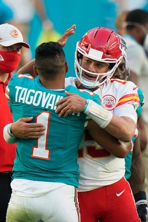 Miami Dolphins quarterback Tua Tagovailoa (1) greets Kansas City Chiefs quarterback Patrick Mahomes (15) at the end of an NFL football game, Sunday, Dec. 13, 2020, in Miami Gardens, Fla. The Chiefs defeated the Dolphins 33-27.