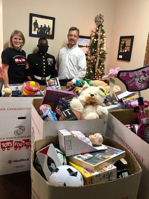 The staff at Boeck Chiropractic Center in New Bern recently collected toys from their patients who together on Wednesday, Dec. 2, helped to raise over 200 toys and 3 bicycles to go to our local Toys For Tots. Staff Sgt. Shawn Rose and Sgt. Arthur Romans had their vehicles (and hearts!) full and it was such a great sight to see. Pictured is Lauren Banks, SSgt. Shawn Rose, and Dr. Thomas Boeck. [CONTRIBUTED PHOTO]
