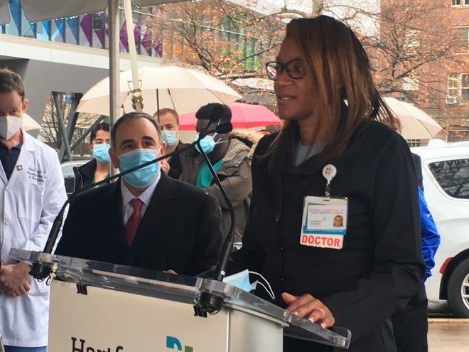 Dr. Melisha Cumberland, chief of the department of medicine at Windham Hospital, speaks Monday at a Hartford Healthcare press conference. She later received her first dose of the vaccine, emphasizing the importance of leaders in the medical community getting vaccinated.