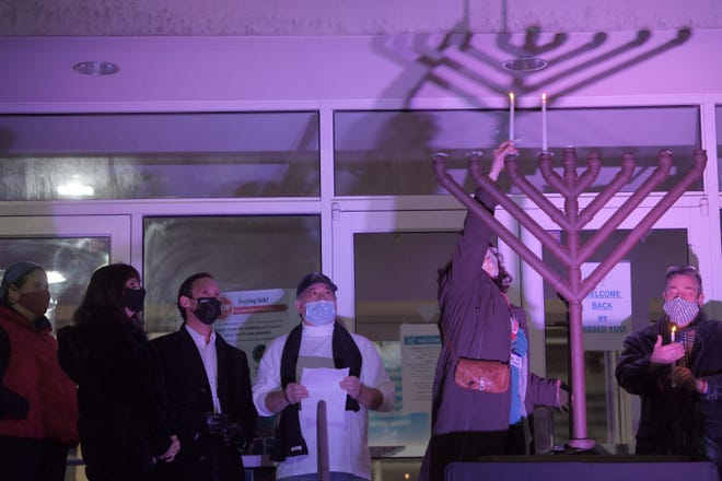 "WORCESTER -  The Jewish Federation of Central Mass. and the Torah Center held a ""Light up the Darkness!""  drive-in menorah lighting on Sunday, Dec. 13, 2020, at the Jewish Community Center on Salisbury Street. People watched the lighting from the safety of their cars."