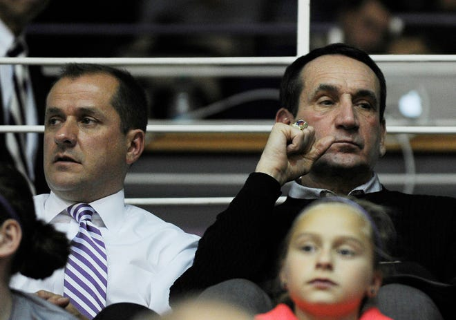 Dec 7, 2013; Evanston, IL, USA; L-R Northwestern Wildcats athletic director Jim Phillips and Duke basketball coach Mike Krzyzewski watch the game between the Northwestern Wildcats and the Western Michigan Broncos at Welsh-Ryan Arena. The Northwestern Wildcats defeated the Western Michigan Broncos 51-35. Mandatory Credit: David Banks-USA TODAY Sports