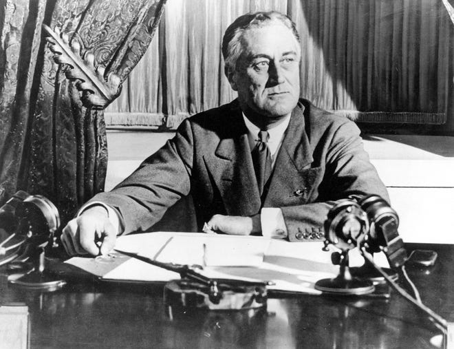 """In this March 1933 photo, President Franklin D. Roosevelt delivers his first radio """"fireside chat"""" in Washington."""