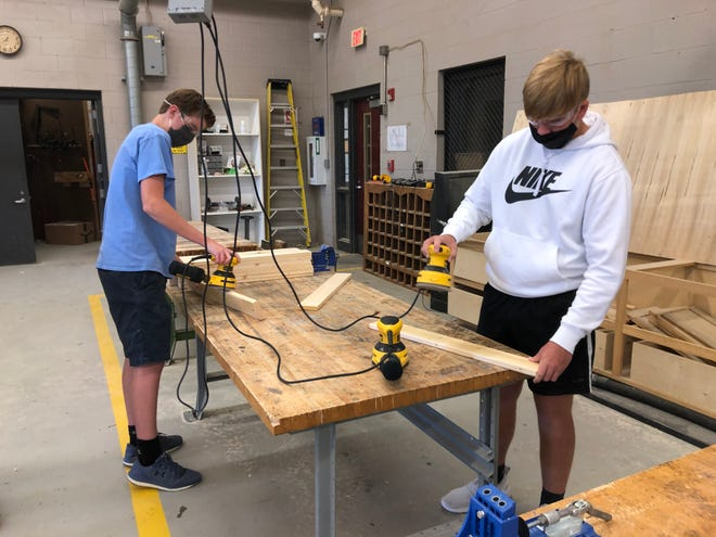 Southside High School FFA students work on building beds for Sleep in Heavenly Peace, whose mission is to ensure that kids ages 3 to 17 have beds to sleep in. A national grant from FFA helped fund the project