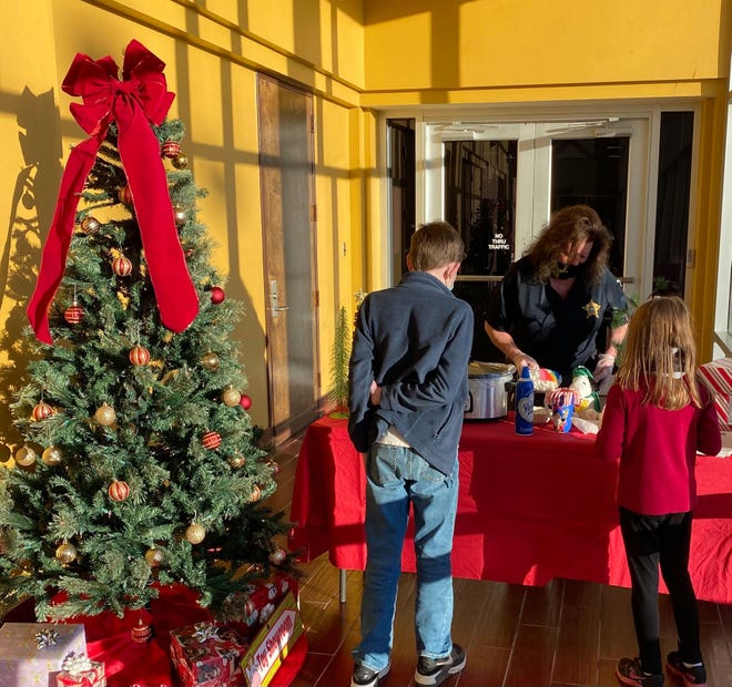 The Etowah County Sheriff's Office Christmas/Awards banquet was handled differently this year because of COVID-19, but families -- especially children -- were invited to enjoy hot chocolate and treats, and to visit with Santa.