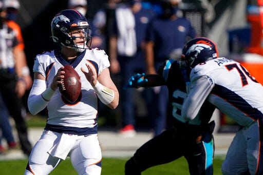 Denver Broncos quarterback Drew Lock looks to pass against the Carolina Panthers during the first half on Sunday in Charlotte, N.C. (AP Photo/Brian Blanco)