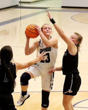 Greenwood's Kinley Fisher shoots over the Fayetteville defense in the third quarter, Tuesday, Dec. 8, at H.B. Stewart Arena in Greenwood. [JAMIE MITCHELL/TIMES RECORD]