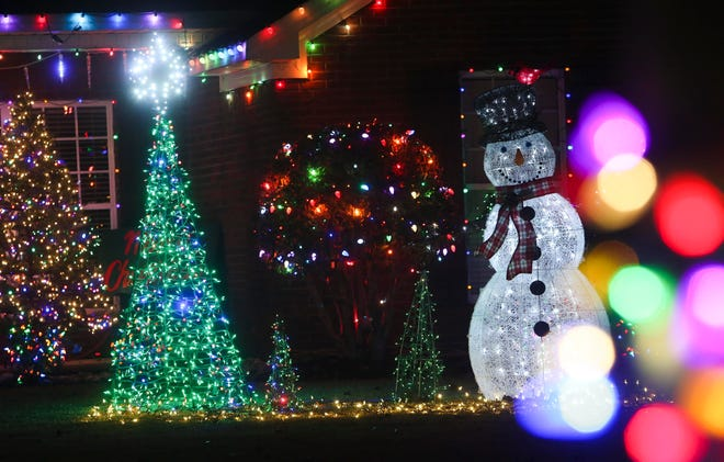 Hundreds of lights and dozens of lit figures grace a lawn in the Cedar Crest neighborhood in Northport on Monday, Dec. 18, 2017.    [Staff file photo]