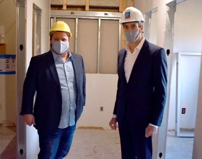 John Geraci, left, and Dennis Clarke in unfinished space LGA is moving into.