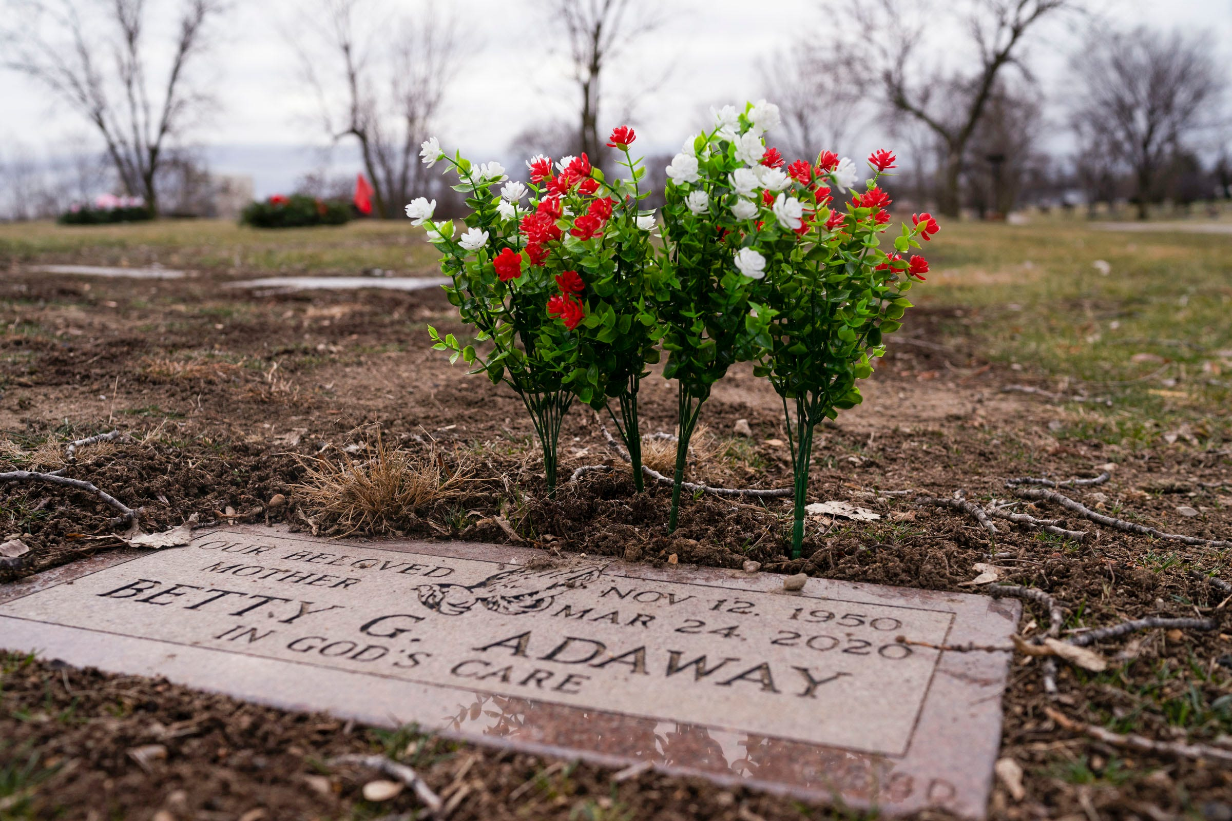 Fresh flowers are placed at Betty Gene Adaway's grave marker at the Detroit Memorial Park on Sunday, Dec. 6, 2020, in Redford Township.