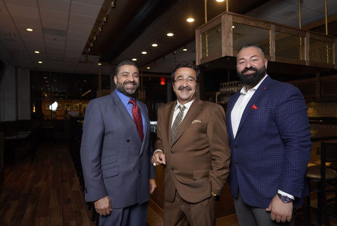 Starters partners (from left) Mike, Bob and Ali Saad, photographed inside their new Southfield location.