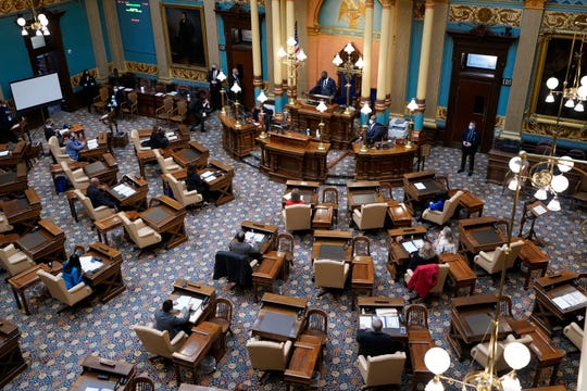 Michigan Lt. Gov. Garlin Gilchrist opens the state's Electoral College session at the state Capitol, Monday, Dec. 14, 2020 in Lansing, Mich.