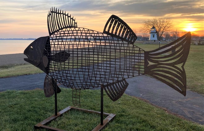 A new fish is installed in Water Works Park in Port Clinton.
