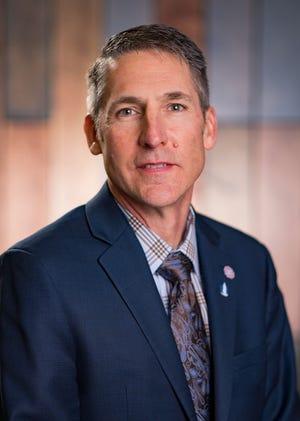 Cy Prettyman of New Bloomington was re-elected treasurer of the Ohio Farm Bureau.