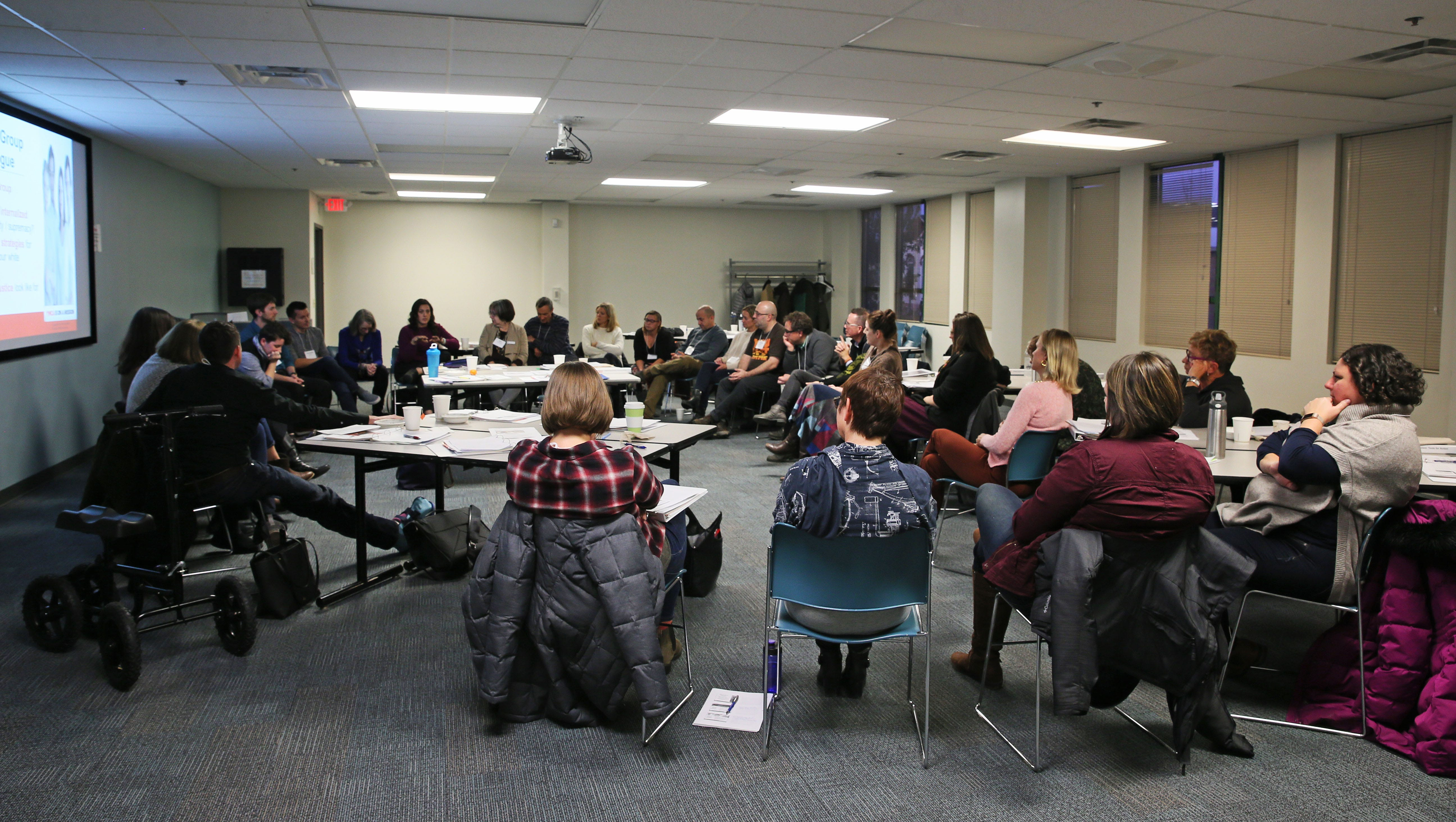 People participating in Unlearning Racism were divided into two groups, white participants shown here and people of color, for an exercise to talk about shared experiences.