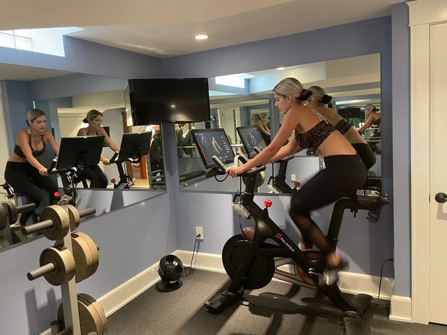 Lynee' Ruiz of West Allis, works out in her home gym. Her husband, Jake Ruiz, is president of QRS Group, a remodeling firm that has been creating a lot of home gyms. The gym at the Ruiz house uses free weights and mirrors, which help exercisers to see if they're maintaining form.
