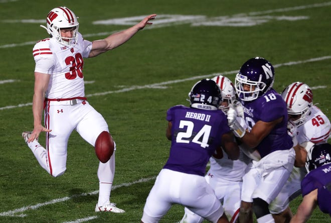 Wisconsin's Andy Vujnovich punts during a game at Northwestern last season.