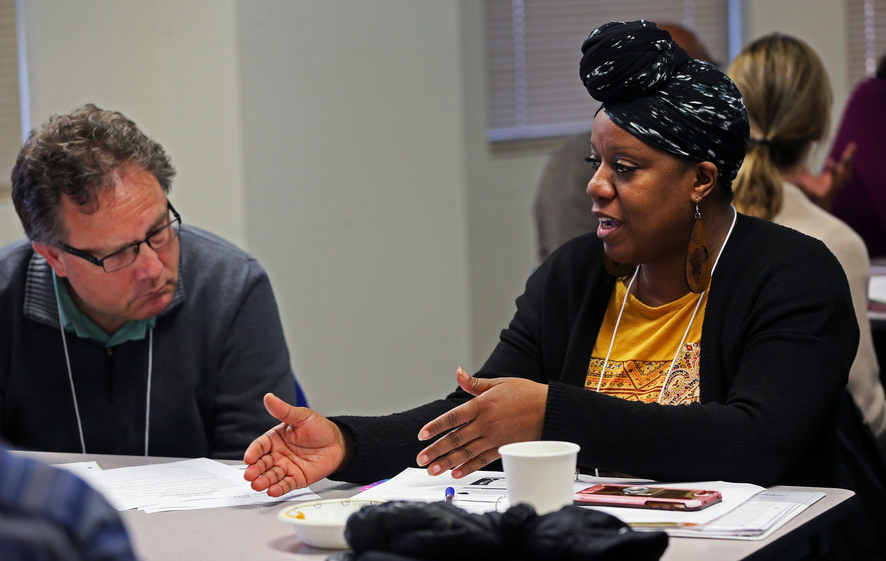 Yvonne Scott, right, shares her opinion on race as Aaron Schutz, left, listens on Thursday, Nov. 7, 2019 at the YWCA.