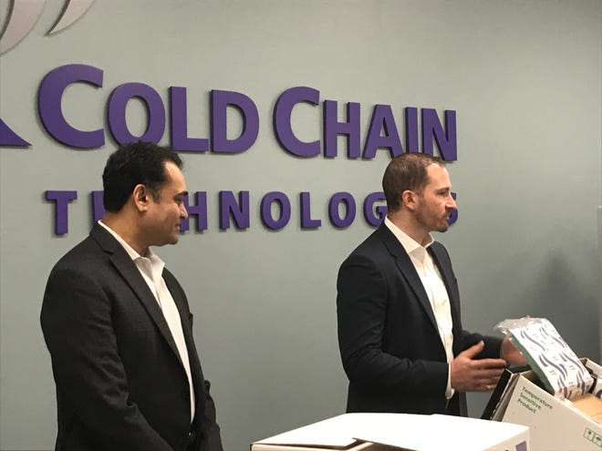 Cold Chain Technologies CEO Ranjeet Banerjee, left, and Chief Commercial Officer Anthony Rizzo, right, explaon elements of thermal packaging materials to be used to store COVID-19 vaccine distribution in transit.