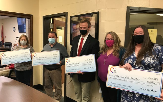 Pictured, from left, are Charlotte Middle School Assistant Principal April Killebrew; Dickson Middle Band Director Shane Joyce; Burns Middle School Principal Corey Duke; Art in the Heart Co-Chair Angela Redden; and William James Middle School Band Director Mollie Mark.