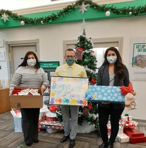 Staff and family of the Telshor branch of  Bank of the West participated in the Sponsor A Child Christmas Gift event this year, benefitting Jardin de los Niños.