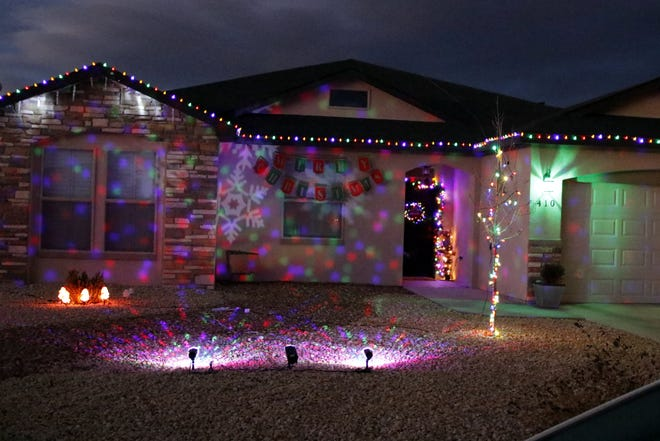The Christmas lights set up around Mo Cordova's house in Carlsbad. The set includes lights around the house, front door decorations and a light show.