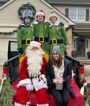 Dominic Dudek, Tyler Hinkson, Mitch Skamiera, JD Michaels and Emma Dalzochio brought some holiday cheer to the SOuuth Lyon community.