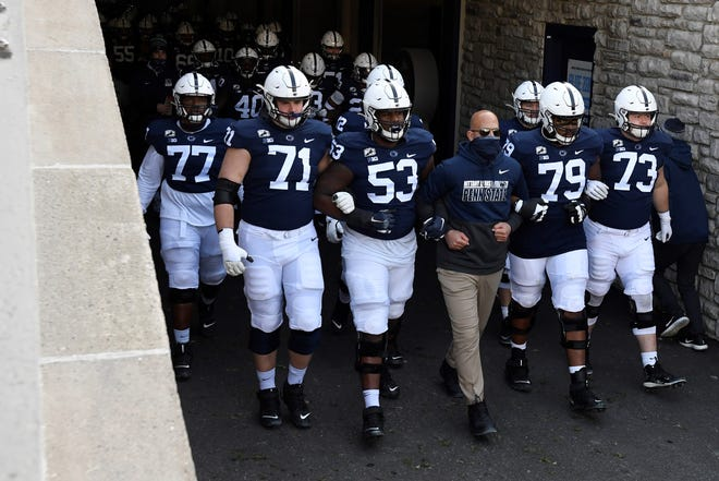 Penn State head coach James Franklin leads his team onto the field for an NCAA college football game against Michigan State in State College, Pa., on Saturday, Dec. 12, 2020. (AP Photo/Barry Reeger)