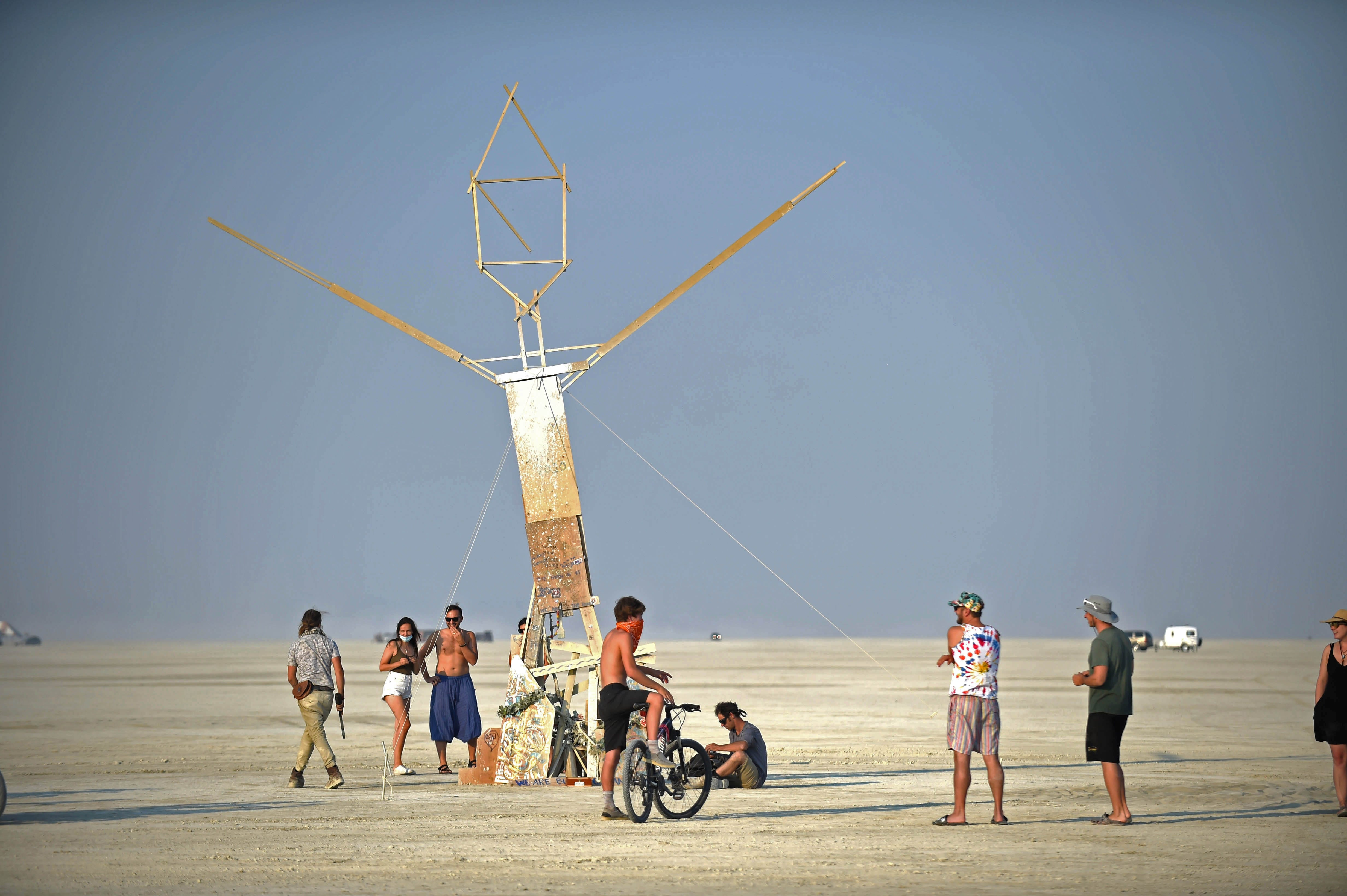 People gather on the Black Rock Desert Sept 5, 2020. Burning Man 2020 was cancelled because of the pandemic, but people still went out to the playa and had their own burn.