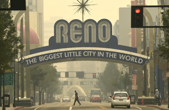 A thick layer of smoke from the Loyalton Fire covers the Reno area on Wednesday, August 19, 2020