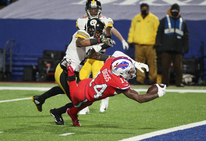 Bills receiver Stefon Diggs lunges to score on this 19-yard touchdown catch.