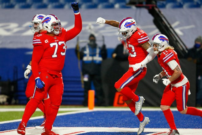 Buffalo Bills wide receiver Gabriel Davis (13) celebrates after taking a pass from Josh Allen for a touchdown during the second half of an NFL football game against the Pittsburgh Steelers in Orchard Park, N.Y., Sunday, Dec. 13, 2020. (AP Photo/Jeffrey T. Barnes )