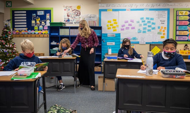 As COVID-19 cases rise throughout the country, All Saints' Day School is one of the few schools in Monterey County that's doing in-person learning in Carmel, Calif., on Thursday, Dec. 10, 2020.