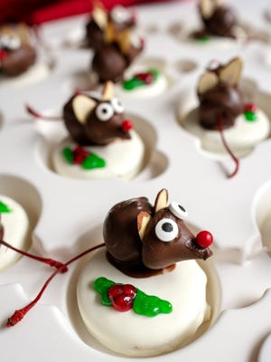 To make these cute little mice, you'll need maraschino cherries with stems, dark chocolate melting wafers, white fudge Oreos.