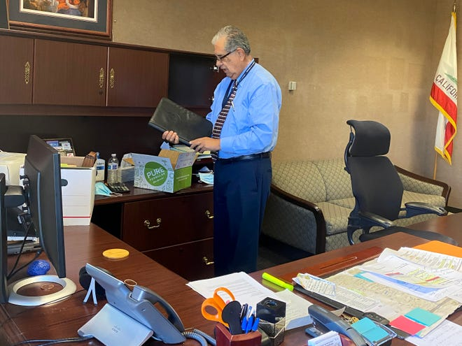 Supervisor John Zaragoza packs up his office at the Government Center in Ventura.