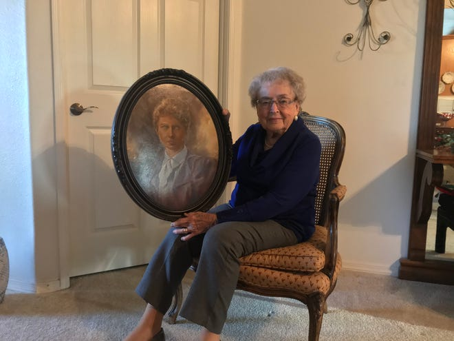 Gerry Soults was a prominent member of the art group Tulare Palette Club and Tulare Historical Museum's first director. She turned 100 in December.  She is holding a painting she did herself of her mother.